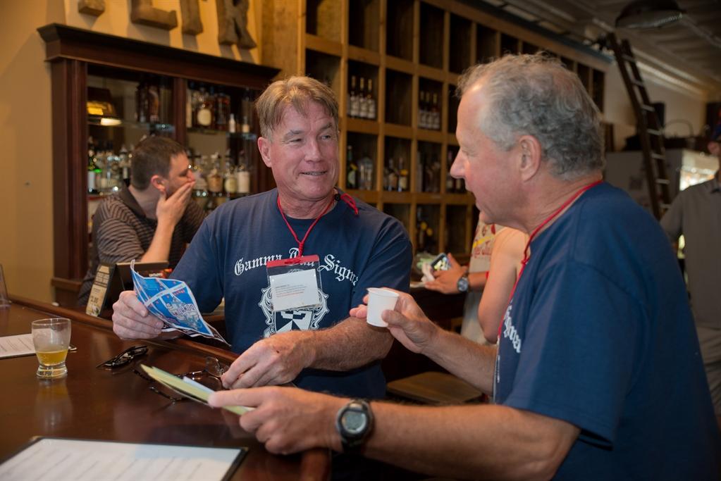 Two alumni enjoying wine at a downtown Cortland tasting room